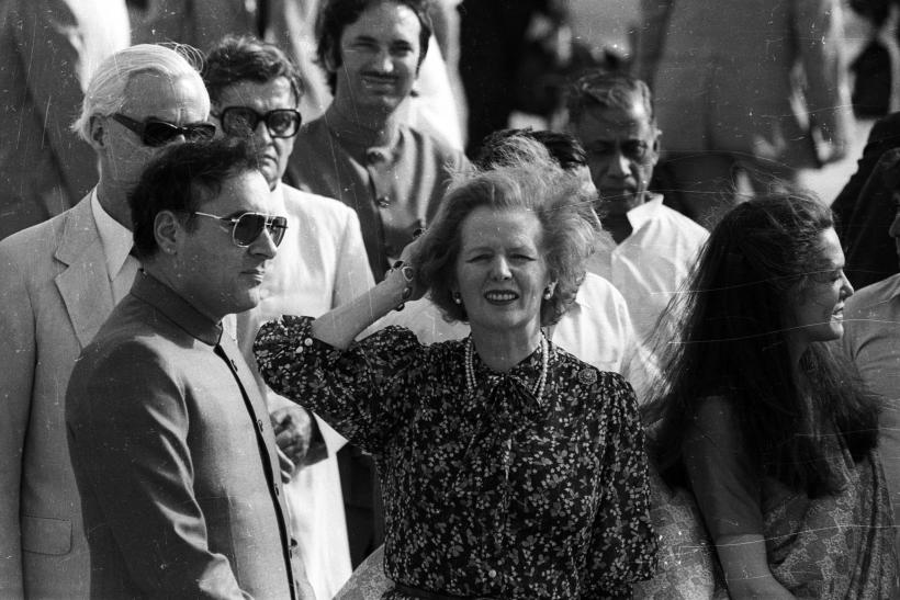 British Prime Minister Margaret Thatcher is welcomed at Delhi's International Airport today by Indian Prime Minister Rajiv Gandhi. Thatcher&#03