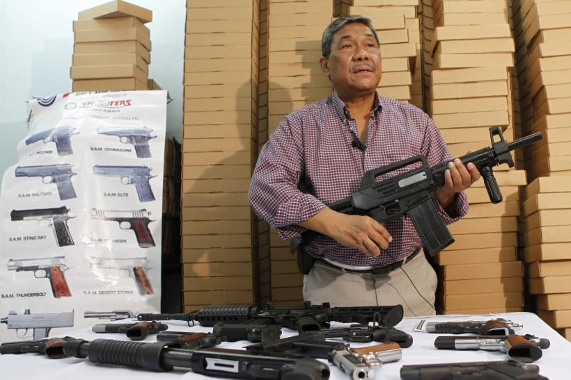 Filipino businessman Romulo de Leon, owner of Shooters Arms, a gun manufacturing company exporting different kinds of weapons to other countries, shows the weapons produced by former illegal gunsmiths in his factory in Cebu city in central Philippines