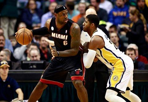 LeBron James backing down Paul George in a Heat versus Pacers 2013 regular season matchup in Indianapolis.