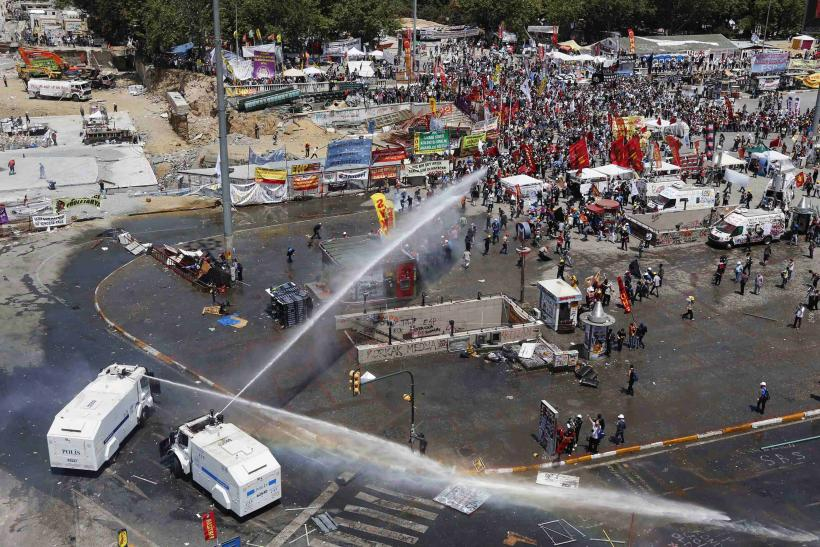 Protesters Run From Water Cannon