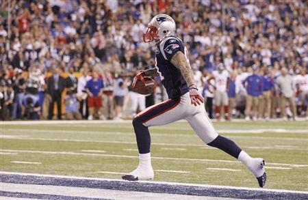 Hernandez Arrested, Cut By Patriots