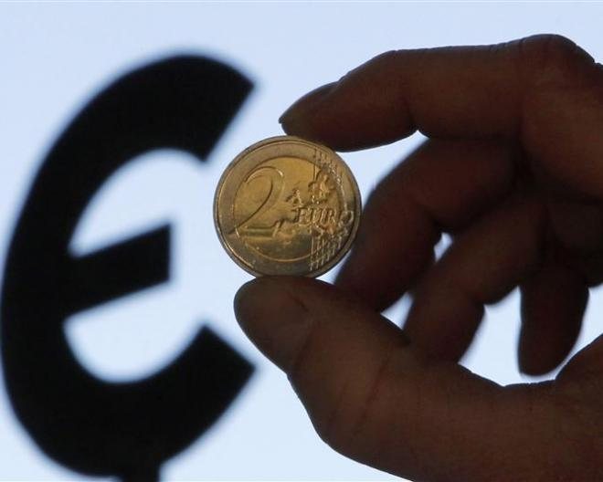 Euro coin and euro logo