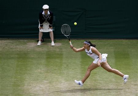 Brutal Bartoli Destroys Flipkens To Reach Wimbledon Final