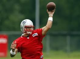 Tebow Catches Passes At Training Camp