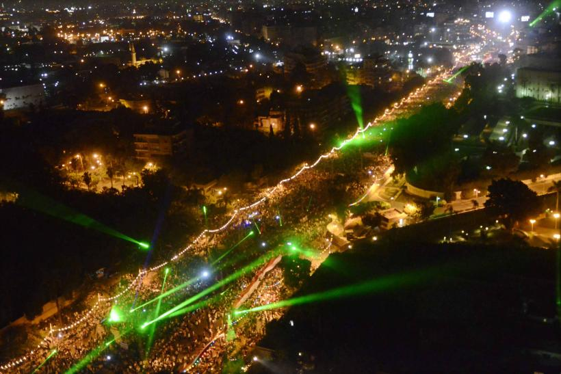 Anti-Morsi rally in Cairo Egypt lit by lasers