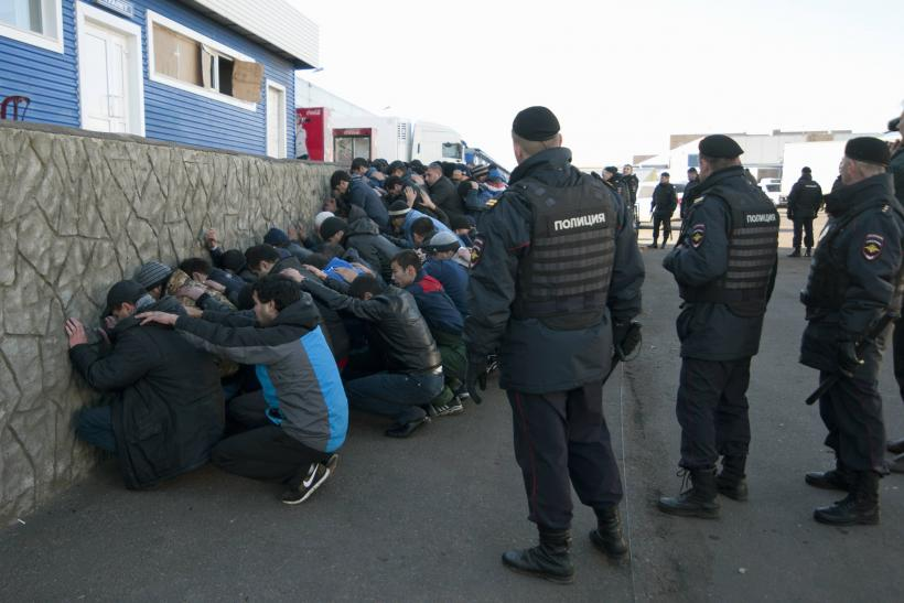 Russian police detain migrants