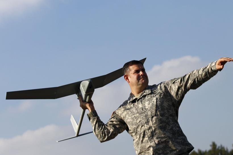 US soldier poses with drone