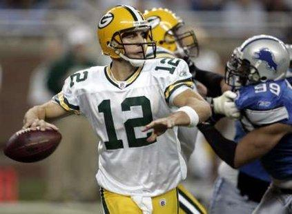 Romo, Rodgers Uncertain For Division Title Games