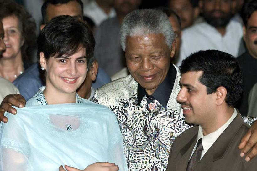 Nelson Mandela hugs Priyanka Gandhi, daughter of Congress party president Sonia Gandhi, and her husband Robert Vadra after receiving the Gandhi Peace Prize in New Delhi March 16, 2001