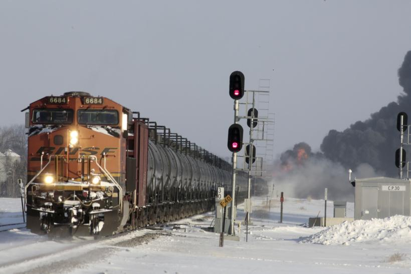A plume of smoke rises behind a train near Casselton, N.D., Monday, Dec. 30, 2013. Reuters
