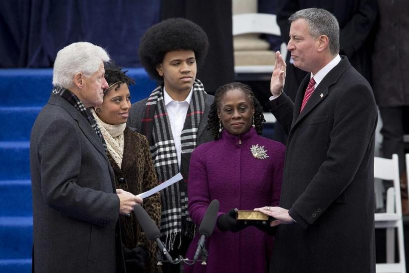 Bill De Blasio was ceremonially sworn in as the 109th mayor by former president Bill Clinton Wednesday. With them were De Blasio's wife, Chirlane Mc