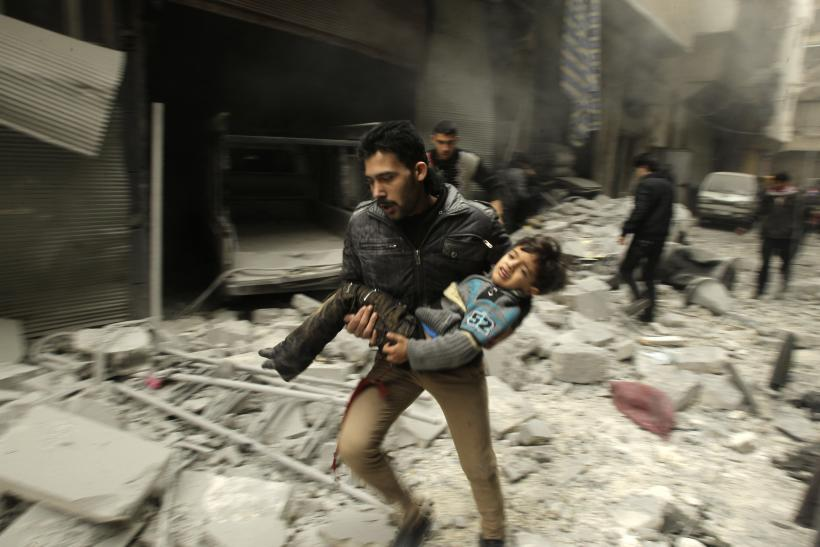 Syrian running with child