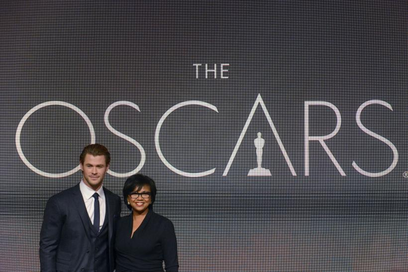 Chris Hemsworth (L) and Academy President Cheryl Boone Isaacs