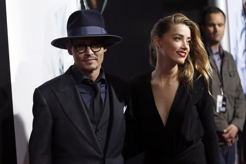 Actors Amber Heard and Johnny Depp at the premiere of  quot 3 Days to Kill    Johnny Depp Amber Heard 2014