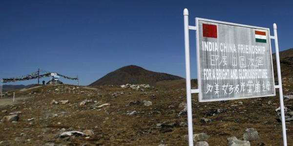 A signboard is seen from the Indian side of the Indo-China border at Bumla, in the northeastern Indian state of Arunachal Pradesh