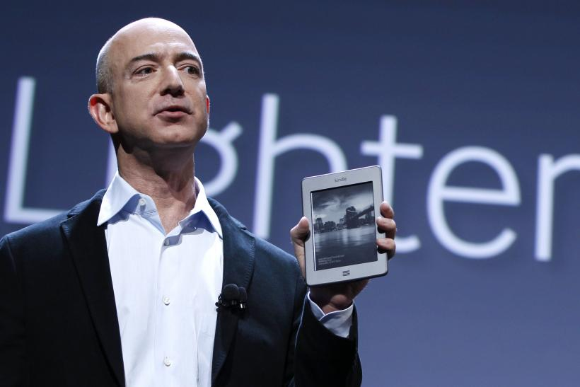 Jeff Bezos holds Amazon Kindle