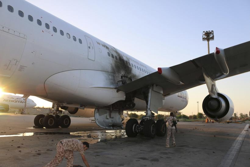 A damaged aircraft is pictured after a shelling at Tripoli International Airport, Libya July 15, 2014