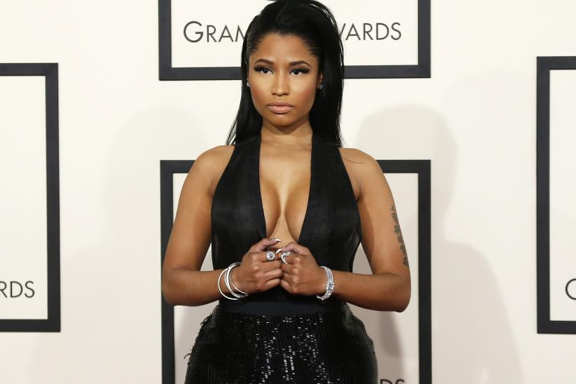 [12:21] Rapper Nicki Minaj arrives at the 57th annual Grammy Awards in Los Angeles