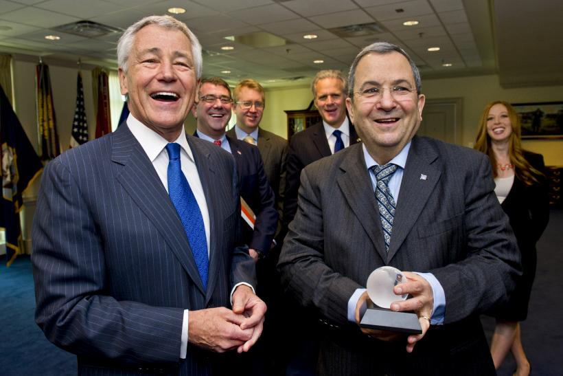 Hagel presentes Barak with a gift at the Pentagon
