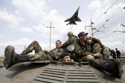 Ukraine's Military Recaptures Airfield, While Putin Warns Of Civil War