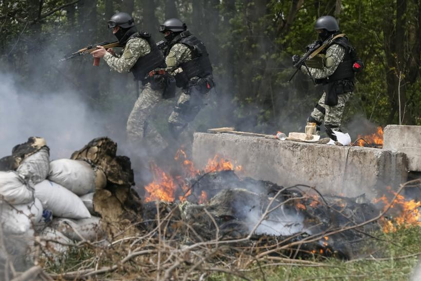 5 Pro-Russia Rebels Killed, Putin Calls Use Of Military Force A 'Serious Crime'