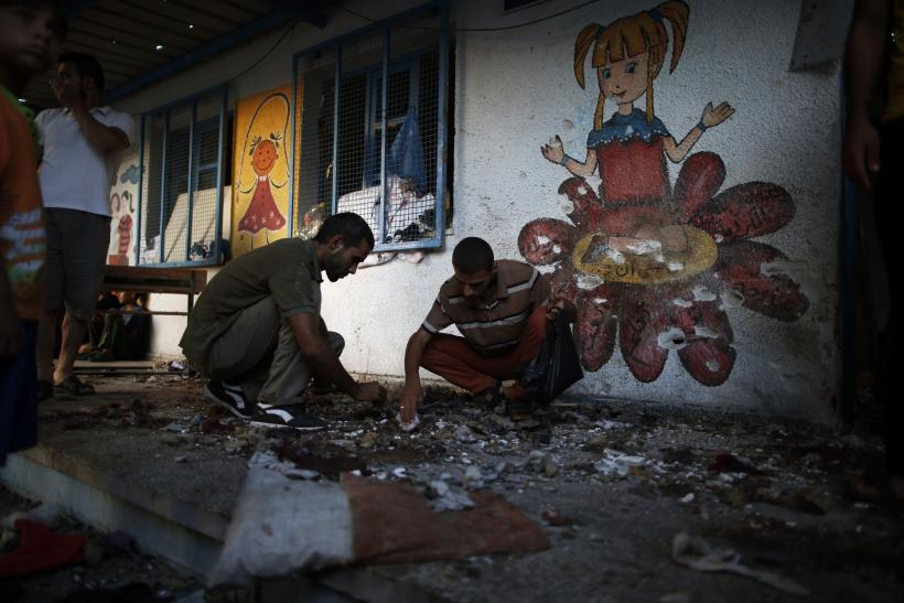 Israeli Shells Hit UN School, Hospital