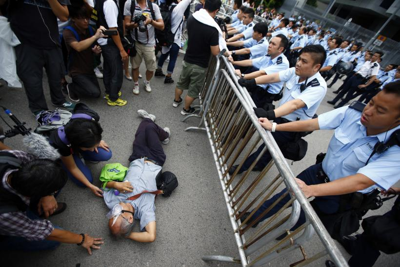 Police Warn Of 'Serious Consequences' If HK Protesters Occupy Buildings