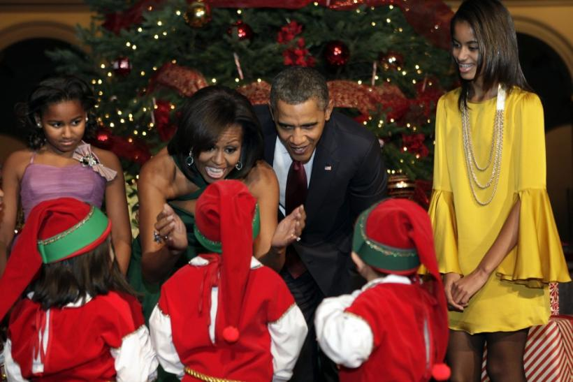 "U.S. President Barack Obama and family greet children, dressed as elves, at the ""Christmas in Washington"" celebration in Washington"