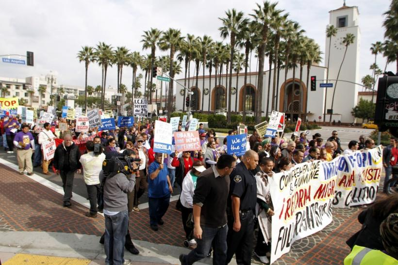 Demonstrators march past the Union Station during an Occupy ICE (Immigration Customs and Enforcement) protest march in Los Angeles