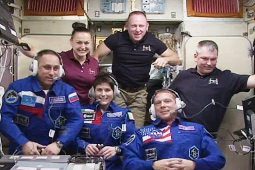 Astronauts Board International Space Station From Soyuz Spacecraft