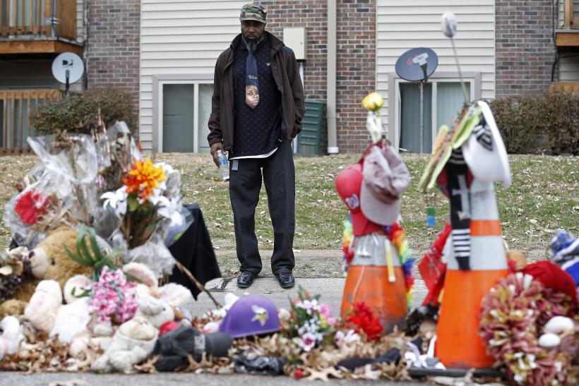 Ferguson Cop Who Called Brown Memorial 'Pile Of Trash' Suspended