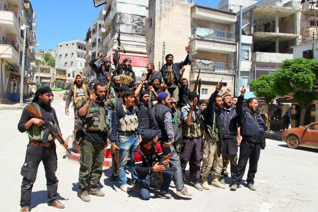 Civilians Slain After Insurgents Took Town, Syrian TV Says