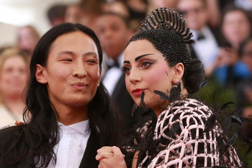 [14:07] U.S. singer Lady Gaga (R) is seen with American fashion designer Alexander Wang after arriving for the Metropolitan Museum of Art Costume Institute Gala 2015
