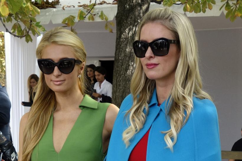 [12:29] Socialites Paris (L) and Nicky Hilton pose after the Valentino Spring/Summer 2015 women's ready-to-wear collection show during Paris Fashion Week
