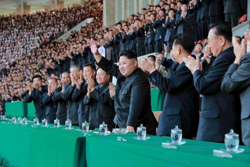 kim Jong Un waves at fans inside the country's national stadium